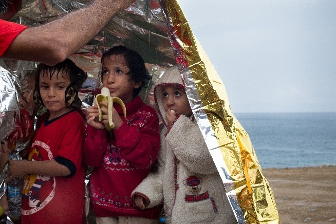 Three refugees arrive the island of Lesbos, Greece (UNICEF 2015).